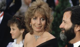 FILE - In this April 9, 1984 file photo, actress Penny Marshall arrives for the 56th Annual Academy Awards in Los Angeles. Marshall died of complications from diabetes on Monday, Dec. 17, 2018, at her Hollywood Hills home. She was 75. (AP Photo/Reed Saxon, File)
