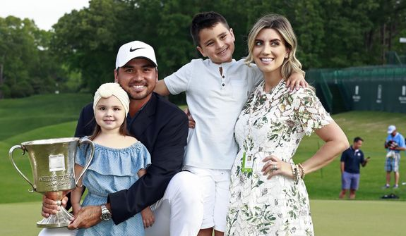 FILE - In this May 6, 2018, file photo, Jason Day poses with, from left to right, his daughter Lucy, son Dash and wife Ellie after winning the Wells Fargo Championship golf tournament at Quail Hollow Club in Charlotte, N.C. Day says he wants to get back to No. 1 and still devote time to his family. (AP Photo/Jason E. Miczek, File) **FILE**