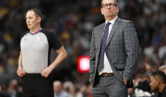 Toronto Raptors head coach Nick Nurse checks the scoreboard as time runs out in the second half of an NBA basketball game against the Denver Nuggets, Sunday, Dec. 16, 2018, in Denver. The Nuggets won 95-86. (AP Photo/David Zalubowski)