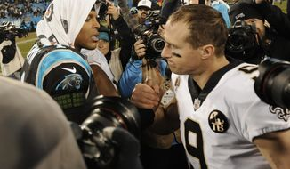 Carolina Panthers' Cam Newton (1) greets New Orleans Saints' Drew Brees (9) after an NFL football game in Charlotte, N.C., Monday, Dec. 17, 2018. (AP Photo/Mike McCarn)