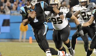 Carolina Panthers' Cam Newton (1) scrambles past New Orleans Saints' Tyeler Davison (95) in the first half of an NFL football game in Charlotte, N.C., Monday, Dec. 17, 2018. (AP Photo/Mike McCarn)
