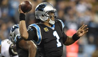 Carolina Panthers' Cam Newton (1) looks to pass against the New Orleans Saints in the first half of an NFL football game in Charlotte, N.C., Monday, Dec. 17, 2018. (AP Photo/Mike McCarn)