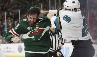 San Jose Sharks' Timo Meier of Switzerland fights Minnesota Wild's Greg Pateryn in the second period of an NHL hockey game Tuesday, Dec. 18, 2018, in St. Paul, Minn. (AP Photo/Stacy Bengs)