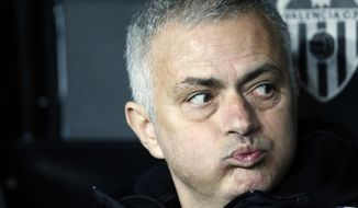 FILE - In this Wednesday, Dec. 12, 2018 file photo Manchester United coach Jose Mourinho looks out from the bench prior a Group H Champions League soccer match between Valencia and Manchester United at the Mestalla Stadium in Valencia, Spain. Manchester United says Jose Mourinho has left the Premier League club with immediate effect. The decision was announced Tuesday Dec.18, 2018, two days after a 3-1 loss to Liverpool left United 19 points off the top of the Premier League after 17 games. (AP Photo/Alberto Saiz)