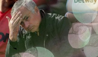 FILE - In this Saturday, Sept. 29, 2018 file photo Manchester United manager Jose Mourinho, seen through foam bubbles, wipes his forehead prior the English Premier League soccer match between West Ham United and Manchester United at London Stadium in London in London, England. Manchester United says Jose Mourinho has left the Premier League club with immediate effect. The decision was announced Tuesday Dec. 19, 2018, two days after a 3-1 loss to Liverpool left United 19 points off the top of the Premier League after 17 games.(AP Photo/Tim Ireland, File)