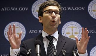 FILE - In this Nov. 28, 2017, file photo, Washington state Attorney General Bob Ferguson speaks at a news conference in Seattle. Google and Facebook are being ordered by a Washington state judge to pay $455,000 for a campaign finance violation case, Ferguson said Tuesday, Dec. 18, 2018. Google will pay $217,000 and Facebook will pay $238,000 in response to two lawsuits filed in June that accused the tech firms of not obeying the state law on political-ad transparency, Ferguson said. (AP Photo/Elaine Thompson, File)