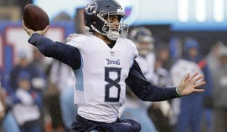 Tennessee Titans quarterback Marcus Mariota throws a pass against the New York Giants during the first half of an NFL football game, Sunday, Dec. 16, 2018, in East Rutherford, N.J. (AP Photo/Seth Wenig)