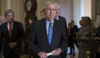 Senate Majority Leader Mitch McConnell, R-Ky., joined by Sen. Roy Blunt, R-Mo., left, and Majority Whip John Cornyn, R-Texas, right, arrives to speak to reporters about the possibility of a partial government shutdown, at the Capitol in Washington, Tuesday, Dec. 18, 2018. Congress and President Donald Trump continue to bicker over his demand that lawmakers fund a wall along the U.S.-Mexico border, pushing the government to the brink of a partial shutdown at midnight Friday. (AP Photo/J. Scott Applewhite)