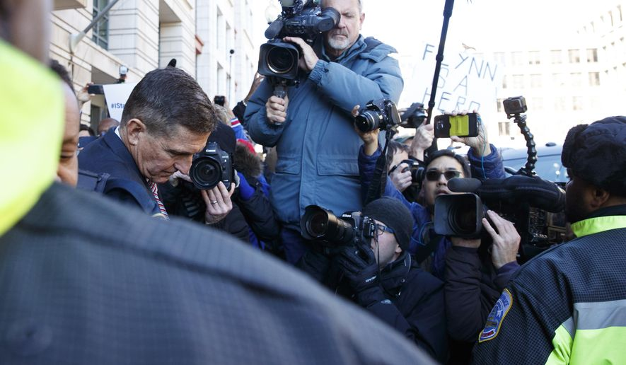 President Donald Trump's former National Security Advisor Michael Flynn leaves federal court in Washington, Tuesday, Dec. 18, 2018. (AP Photo/Carolyn Kaster)