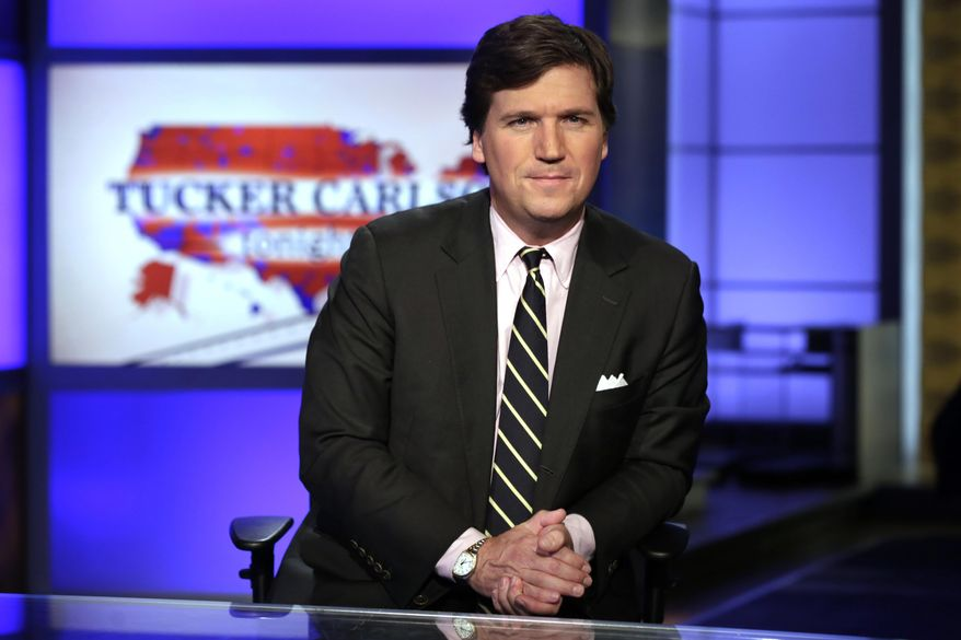 """In this March 2, 2017, file photo, Tucker Carlson, host of """"Tucker Carlson Tonight,"""" poses for photos in a Fox News Channel studio in New York. (AP Photo/Richard Drew, File)"""