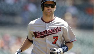 FILE - In this July 20, 2016, file photo, Minnesota Twins' Joe Mauer heads home after his solo home run during the first inning of a baseball game against the Detroit Tigers, in Detroit.  The Minnesota Twins will retire Joe Mauer's No. 7 jersey next season, moving swiftly with the prestigious honor for the six-time All-Star who recently finished a 15-year major league career. The Twins surprised Mauer with the announcement while he was being celebrated at an all-student assembly at his alma mater Cretin-Derham Hall High School on Tuesday, Dec. 18, 2018.(AP Photo/Carlos Osorio, File)