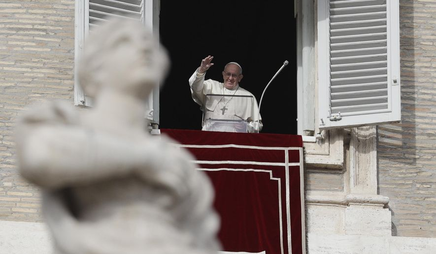 Pope Francis waves to faithful during the Angelus noon prayer in St. Peter's Square, at the Vatican, Sunday, Dec. 16, 2018. (AP Photo/Gregorio Borgia)