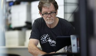FILE - In this Monday, June 4, 2018, file photograph, baker Jack Phillips, owner of Masterpiece Cakeshop, manages his shop after the U.S. Supreme Court ruled that he could refuse to make a wedding cake for a same-sex couple because of his religious beliefs did not violate Colorado's anti-discrimination law in Lakewood, Colo. Attorneys for Philliups are in federal court in Denver Tuesday, Dec. 18, 2018, to seek to overturn a Colorado Civil Rights Commission ruling that the baker discriminated against a transgender person by refusing to make a cake to mark the person's transition from male to female. (AP Photo/David Zalubowski, File)