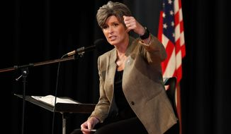 """Bring it on,"" said Sen. Joni Ernst, Iowa Republican, about the upcoming 2020 election and her unnamed Democratic opponent. (Associated Press)"