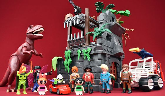 Gift ideas include Playmobile's Spengler with Cage Car and Hidden Temple with T-Rex and Lego's Mojo Jojo Strikes. (Photograph by Joseph Szadkowski / The Washington Times)