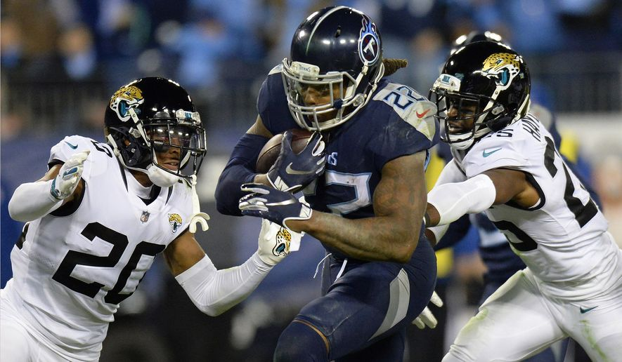 FILE - In this Thursday, Dec. 6, 2018, file photo, Tennessee Titans running back Derrick Henry (22) runs for a touchdown past Jacksonville Jaguars cornerback Jalen Ramsey (20) during the second half of an NFL football game in Nashville, Tenn. Unthinkable at the start of December, Henry has piled up a franchise-record 408 yards over his past two games to put the Titans running back 118 yards shy of his first 1,000-yard rushing season. (AP Photo/Mark Zaleski, File) **FILE**