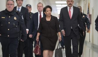 Former Attorney General Loretta Lynch arrives on Capitol Hill in Washington, Wednesday, Dec. 19, 2018, to appear before the GOP-led House Judiciary and Oversight Committees in their probe of conduct by federal law enforcement officials in the investigation of President Trump's alleged Russia ties, and Hillary Clinton's emails. The panels also interviewed former FBI Director James Comey. (AP Photo/J. Scott Applewhite)