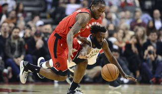 Toronto Raptors forward Kawhi Leonard (2) and Indiana Pacers guard Tyreke Evans (12) battle for the loose ball during the first half of an NBA basketball game, Wednesday, Dec. 19, 2018 in Toronto. (Frank Gunn/The Canadian Press via AP)