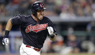 FILE - In this Sept. 19, 2018 file photo Cleveland Indians' Michael Brantley runs to first base on a passed ball in the third inning of a baseball game against the Chicago White Sox in Cleveland. A person familiar with the negotiations tells The Associated Press the Houston Astros have agreed to a two-year deal with free agent outfielder Michael Brantley. The person spoke on the condition of anonymity Monday, Dec. 17, 2018 because the club has not yet announced the move. (AP Photo/Tony Dejak, file)