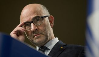 European Commissioner for Economic and Financial Affairs Pierre Moscovici pauses before speaking during a media conference at EU headquarters in Brussels, Wednesday, Dec. 19, 2018. The European Commission says it has reached an agreement with Italy to avert action over the country's budget plans, which the EU's executive arm had warned could break euro currency rules. (AP Photo/Virginia Mayo)