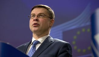 European Commissioner for Euro and Social Dialogue Valdis Dombrovkis speaks during a media conference at EU headquarters in Brussels, Wednesday, Dec. 19, 2018. The European Commission says it has reached an agreement with Italy to avert action over the country's budget plans, which the EU's executive arm had warned could break euro currency rules. (AP Photo/Virginia Mayo)