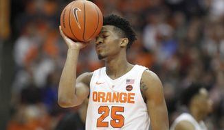 Syracuse's Tyus Battle shows his frustration late in the second half of an NCAA college basketball game against Buffalo in Syracuse, N.Y., Tuesday, Dec. 18, 2018. Buffalo won 71-59. (AP Photo/Nick Lisi)