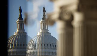 The U.S. Capitol Building Dome is seen through a beveled window at the Library of Congress in Washington, Wednesday, Dec. 19, 2018. (AP Photo/Carolyn Kaster)