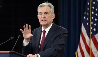 Federal Reserve Chairman Jerome Powell speak at a news conference in Washington, Wednesday, Dec. 19, 2018. The Federal Reserve is raising its key interest rate for the fourth time this year to reflect the U.S. economy's continued strength but signaling that it expects to slow hikes next year. (AP Photo/Susan Walsh)