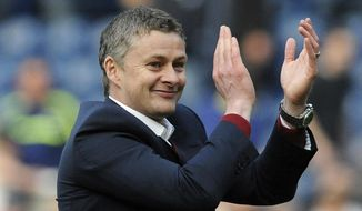 FILE - In this Saturday, March 29, 2014 file photo, Cardiff manager Ole Gunnar Solskjaer applauds fans after the English Premier League soccer match between West Bromwich Albion and Cardiff City at Hawthorns Stadium in West Bromwich, England. Manchester United announced Wednesday Dec. 19, 2018, they have hired Ole Gunnar Solskjaer as its manager until the end of the season, bringing the Norwegian back to the club 20 seasons after he scored its winning goal in the Champions League final. (AP Photo/Rui Vieira, File)