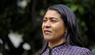 """FILE - In this Oct. 2, 2018, file photo, San Francisco Mayor London Breed listens during a news conference in San Francisco. Breed has requested an early release from prison for an older brother who has served nearly two decades of a 44-year sentence for a manslaughter conviction. The San Francisco Chronicle reported Wednesday, Dec. 19, 2018, that Breed sent a letter to outgoing Gov. Jerry Brown in late October asking him to """"consider leniency"""" and commute her brother's sentence. (AP Photo/Eric Risberg, File)"""