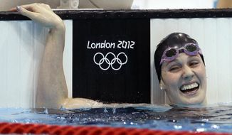 FILE - In this Aug. 3, 2012, file photo, United States' Missy Franklin reacts to her gold medal win in the women's 200-meter backstroke final at the Aquatics Centre in the Olympic Park during the 2012 Summer Olympics in London. The five-time Olympic champion is retiring from swimming at age 23, citing chronic shoulder pain that has affected her for the last 2 and a half years. (AP Photo/Michael Sohn, File)