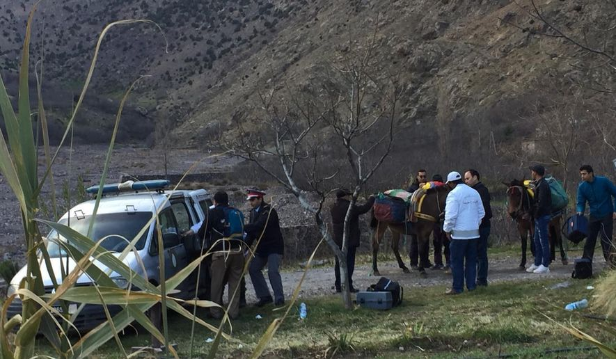 In this photo provided by Moroccan news channel 2M and taken on Tuesday, Dec. 18, 2018, a security team is seen at the area where the bodies of two Scandinavian women tourists were found dead, near Imlil in the High Atlas mountains, Morocco. The lone suspect arrested in the killing of two female Scandinavian tourists is connected to a terrorist group, and three other suspects are on the run, Moroccan prosecutors said Wednesday.(2M via AP)