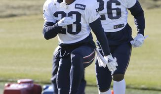 New England Patriots running backs James White, left, and Sony Michel, right, warm up during an NFL football practice, Wednesday, Dec. 19, 2018, in Foxborough, Mass. (AP Photo/Steven Senne)