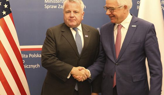 U.S. deputy secretary of state, John Sullivan, right, shakes hands with Polish Foreign Minister Jacek Czaputowicz in Warsaw, Poland, Wednesday, Dec. 19, 2018.The meeting comes as part of a tour by Sullivan to the region. The State Department said ahead of the visit that the reason for his visit to Poland was to reaffirm the U.S. commitment to NATO and commend Poland for its contributions to the alliance's common defense and its efforts to advance energy security.(AP Photo/Czarek Sokolowski)
