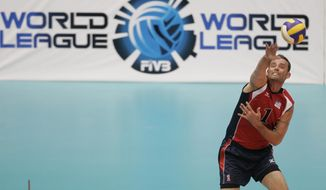 FILE - In this July 23, 2008 file photo, U.S. Lloy Ball serves during a World League volleyball match against Serbia in Rio de Janeiro. Four-time Olympian Ball will lead an American delegation to a European snow volleyball tournament in Moscow this week. The ultimate goal: helping snow volleyball earn a spot in the Olympics - perhaps by 2026. (AP Photo/Ricardo Moraes, File)