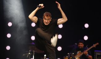 FILE - In this file photo dated Saturday, Nov. 11, 2017, musician Johnny Clegg performs on stage during his own farewell concert in Johannesburg.  The 65-year old Clegg who has survived pancreatic cancer for the last few years, says in an interview broadcast Tuesday Dec. 18, 2018, he has a greater awareness of mortality and enjoys  feeding birds in his garden. (AP Photo/Denis Farrell, File)