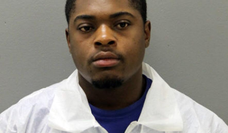 This photo provided by the Chicago Police Department shows Edward Brown, 24. Brown is facing two felony weapons charges in connection with the deaths of two Chicago police officers who were struck and killed by a commuter train while they were chasing him. Chicago police said Wednesday, Dec. 19, 2018, that  Brown is charged with reckless discharge of a firearm-endangerment and aggravated unlawful use of a weapon-loaded. He's due in bond court Thursday.  (Chicago Police Department via AP)