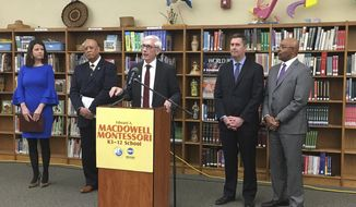 Governor-elect Tony Evers announces key cabinet official appointments at MacDowell Montessori School in Milwaukee Wednesday, Dec. 19, 2018. From left to right are: Sara Meaney, Department of Tourism; Kevin A. Carr, Department of Corrections; Evers; Joel Brennan, Department of Administration; and Preston Cole, Department of Natural Resources.  (Michael Sears/Milwaukee Journal-Sentinel via AP)