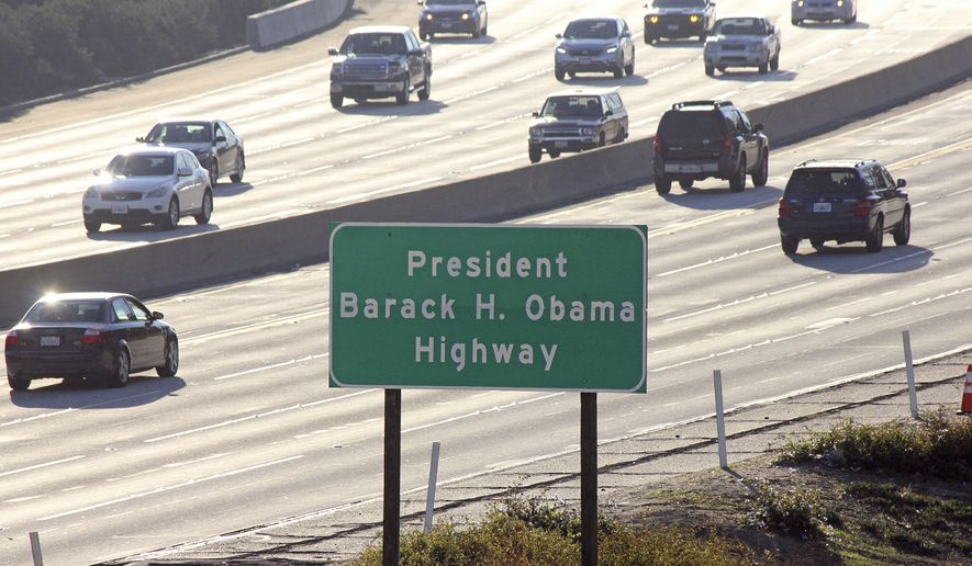 Signs have gone up naming a section of a Los Angeles-area freeway as the President Barack H. Obama Highway, seen from Pasadena, Calif., Thursday, Dec. 20, 2018. The signs posted Thursday on State Route 134 apply to a stretch running from State Route 2 in Glendale, Calif., through the Eagle Rock section of Los Angeles to Interstate 210 in Pasadena. The former president attended Occidental College in Eagle Rock from 1979 to 1981 and lived in Pasadena.  (AP Photo/John Antczak)