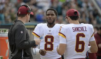 Washington Redskins passing game coordinator Kevin O'Connell, left, talks with quarterback Josh Johnson (8) and quarterback Mark Sanchez (6) on the sideline during the first half of an NFL football game against the Jacksonville Jaguars Sunday, Dec. 16, 2018, in Jacksonville, Fla. (AP Photo/Phelan M. Ebenhack) **FILE**