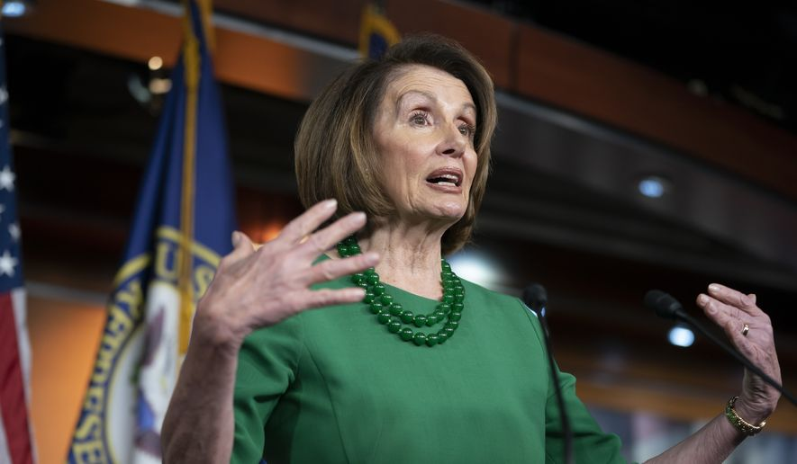 House Democratic Leader Nancy Pelosi of California, talks to reporters as Congress tries to pass legislation that would avert a partial government shutdown, at the Capitol in Washington, Thursday, Dec. 20, 2018. (AP Photo/J. Scott Applewhite)
