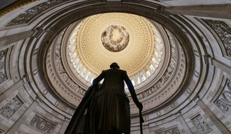 The statue of George Washington is seen beneath the Rotunda in the Capitol in this Dec. 20, 2018 photo. (AP Photo/J. Scott Applewhite) **FILE**