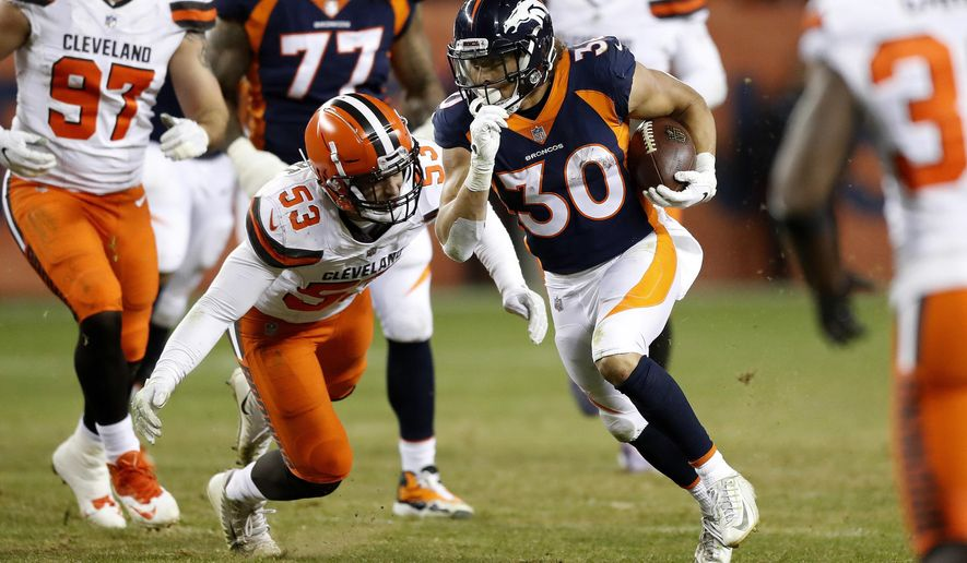 FILE - In this Saturday, Dec. 15, 2018 file photo, Denver Broncos running back Phillip Lindsay (30) runs as Cleveland Browns middle linebacker Joe Schobert (53) pursues during the second half of an NFL football game in Denver. Phillip Lindsay never once thought he'd become the first undrafted offensive player to make the Pro Bowl. He's been too busy making tacklers miss and general managers regret passing him over in the NFL draft because he stands just 5-foot-8.(AP Photo/Jack Dempsey, File)