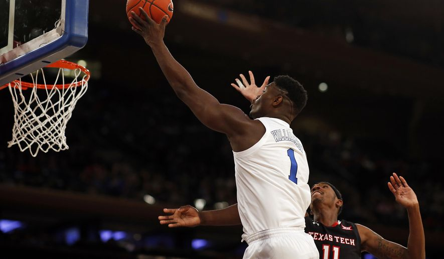 Duke forward Zion Williamson (1) drives to the basket past Texas Tech forward Tariq Owens (11) during the first half of an NCAA college basketball game Thursday, Dec. 20, 2018, in New York. (AP Photo/Adam Hunger)