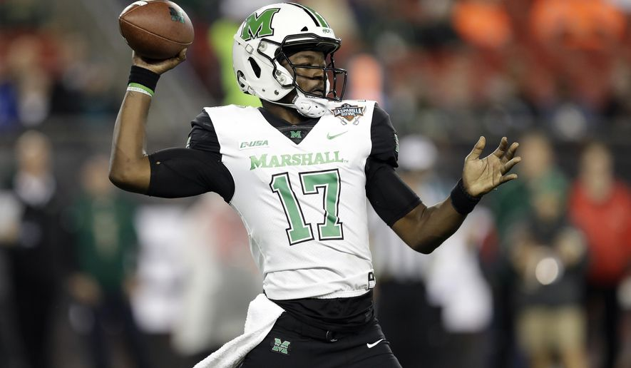 Marshall quarterback Isaiah Green throws a pass during the first half of the Gasparilla Bowl NCAA college football game against South Florida on Thursday, Dec. 20, 2018, in Tampa, Fla. (AP Photo/Chris O'Meara)