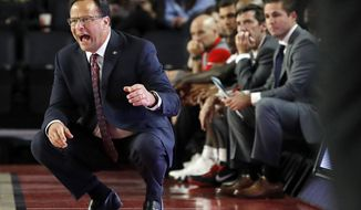 FILE - In this Nov. 27, 2018, file photo, Georgia coach Tom Crean yells out from in front of the Georgia bench during an NCAA college basketball game against Kennesaw State in Athens, Ga. Crean knows college football is king in this part of the country. Of course, it's been a bit of a culture shock to go from hoops-crazy Indiana to a state that treats the sport with a collective meh. Yet there's no reason he can't build a basketball powerhouse at Georgia. (Jenn Finch/Athens Banner-Herald via AP, File)
