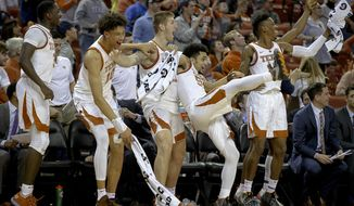 Texas players react to a 3-pointer made by walk-on guard Drayton Whiteside during an NCAA college basketball game against Grand Canyon on Saturday, Dec. 15, 2018, in Austin, Texas. (Nick Wagner/Austin American-Statesman via AP)