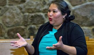 Undocumented Rosa Gutierrez Lopez of El Salvador speaks during an interview with The Associated Press after she sought sanctuary at Cedar Lane Unitarian Universalist Church in Bethesda Md., on Monday Dec. 17, 2018. Advocates say she is the first undocumented immigrant to take refuge at a Washington area house of worship. (AP Photo/Jose Luis Magana)