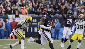 FILE - In this Sunday, Dec. 16, 2018 file photo, Chicago Bears running back Jordan Howard (24) runs to the end zone for a touchdown during the first half of an NFL football game against the Green Bay Packers in Chicago. The Chicago Bears (10-4) already won the NFC North to complete a worst-to-first turnaround and the Houston Texans (10-4) are on the verge of securing the AFC South to become the second team to do it this season. (AP Photo/Nam Y. Huh, File) **FILE**