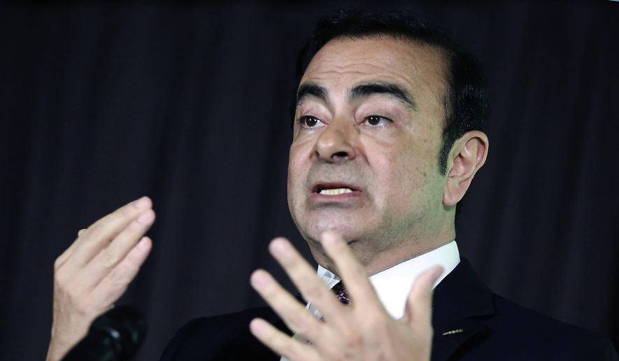 In this May 12, 2016, file photo, then Nissan Motor Co. President and CEO Carlos Ghosn speaks during a joint press conference with Mitsubishi Motors Corp. in Yokohama, near Tokyo. Japanese media said Friday, Dec. 21, 2018, that prosecutors press new allegation of breach of trust against Nissan ex-chair Ghosn, who is being detained in the Tokyo Detention Center. (AP Photo/Eugene Hoshiko)